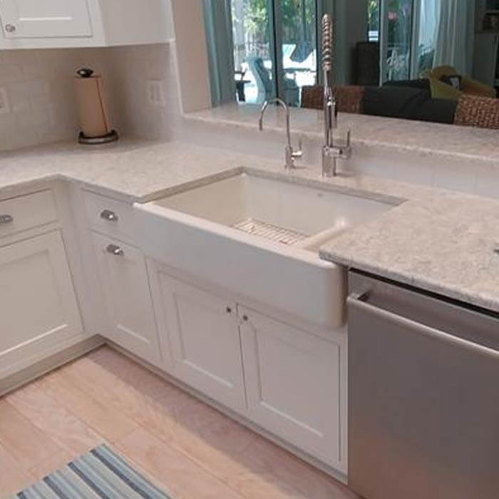 White Shaker cabinets with farm Sink